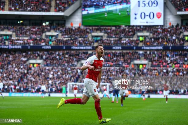 Aaron Ramsey of Arsenal celebrates after scoring a goal to make it 01 during the Premier League match between Tottenham Hotspur and Arsenal FC at...