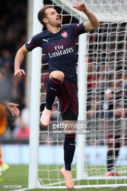 Aaron Ramsey of Arsenal celebrates after scoring a goal to make it 31 during the Premier League match between Fulham FC and Arsenal FC at Craven...
