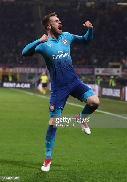 Aaron Ramsey of Arsenal celebrates after scoring during the UEFA Europa League Round of 16 match between AC Milan and Arsenal at the San Siro on...