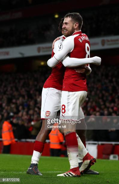 Aaron Ramsey of Arsenal celebrates after scoring his sides fifth goal with Alex Iwobi of Arsenal during the Premier League match between Arsenal and...