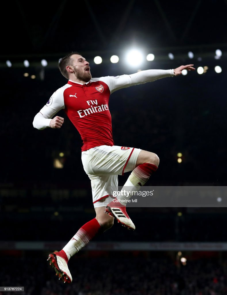 Aaron Ramsey of Arsenal celebrates after scoring his sides fifth goal and his hat-trick during the Premier League match between Arsenal and Everton at Emirates Stadium on February 3, 2018 in London, England.