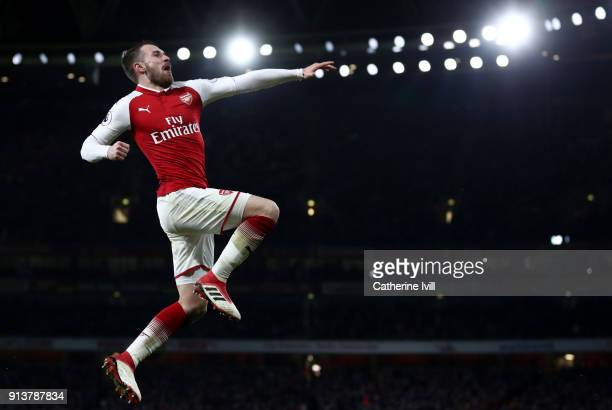 Aaron Ramsey of Arsenal celebrates after scoring his sides fifth goal and his hattrick during the Premier League match between Arsenal and Everton at...