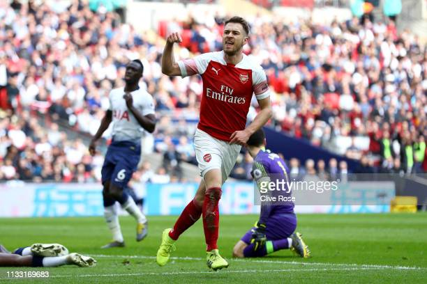Aaron Ramsey of Arsenal celebrates after scoring his team's first goal during the Premier League match between Tottenham Hotspur and Arsenal FC at...