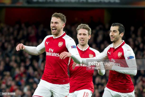 Aaron Ramsey of Arsenal celebrates after scoring his team`s first goal with team mates Nacho Monreal of Arsenal and Henrikh Mkhitaryan of Arsenal...