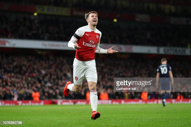 Aaron Ramsey of Arsenal celebrates after scoring his team's third goal during the Premier League match between Arsenal FC and Fulham FC at Emirates...