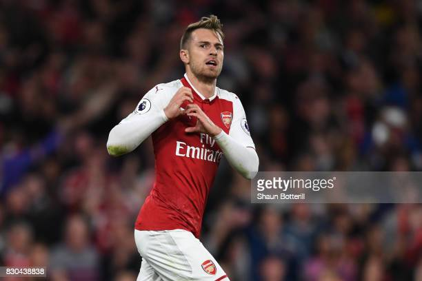 Aaron Ramsey of Arsenal celebrates after scoring his team's third goal during the Premier League match between Arsenal and Leicester City at the...