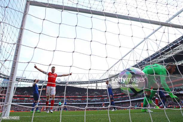 Aaron Ramsey of Arsenal celebrates his sides second goal as David De Gea of Manchester United fails to stop Luke Shaw of Manchester United header...