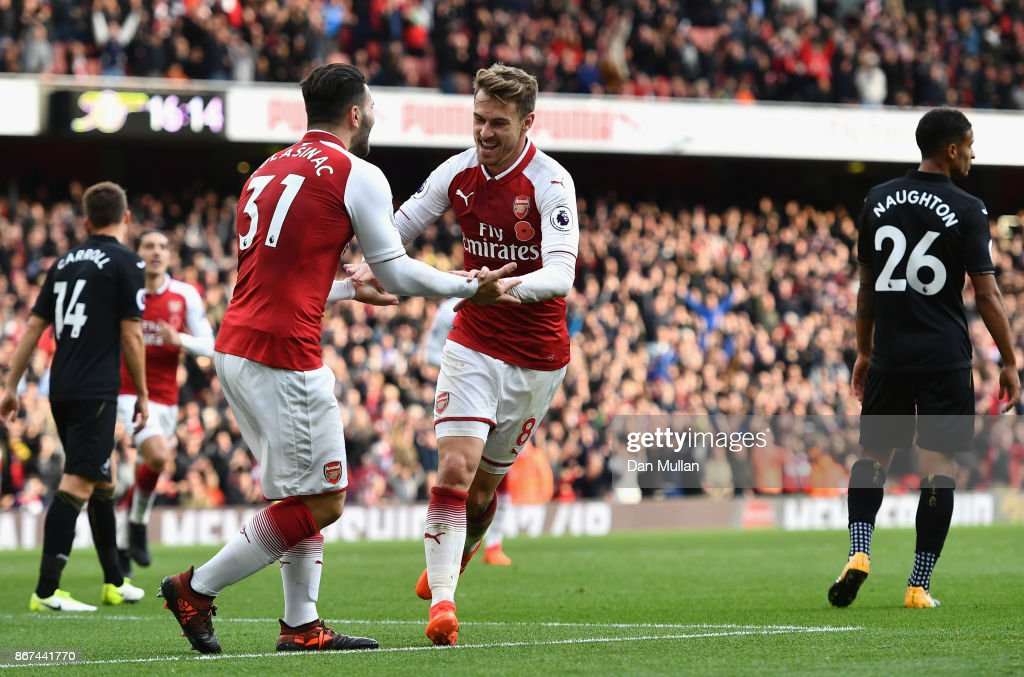Aaron Ramsey of Arsenal celebrates scoring his sides second goal with Sead Kolasinac of Arsenal during the Premier League match between Arsenal and Swansea City at Emirates Stadium on October 28, 2017 in London, England.