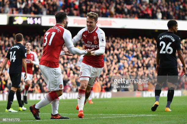 Aaron Ramsey of Arsenal celebrates scoring his sides second goal with Sead Kolasinac of Arsenal during the Premier League match between Arsenal and...
