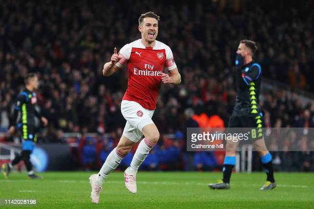 Aaron Ramsey of Arsenal celebrates scoring his teams first goal of the game during the UEFA Europa League Quarter Final First Leg match between...