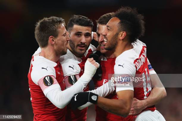 Aaron Ramsey of Arsenal celebrates scoring his teams first goal of the game with team mates Nacho Monreal Sead Kolasinac and PierreEmerick Aubameyang...