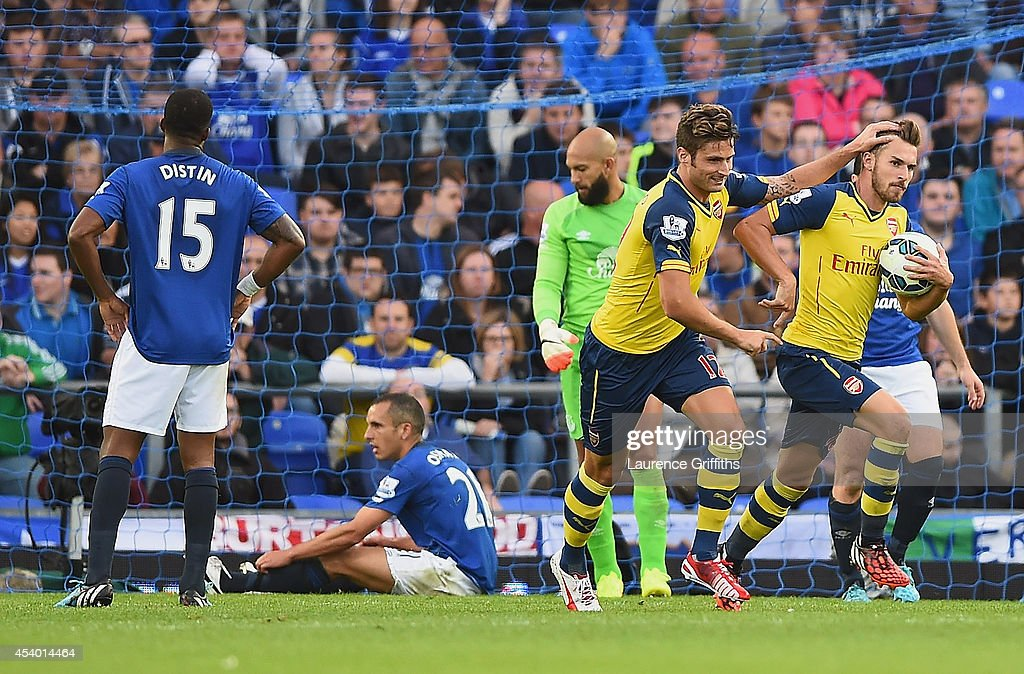 Aaron Ramsey of Arsenal celebrates scoring his team's first goal during the Barclays Premier League match between Everton and Arsenal at Goodison Park on August 23, 2014 in Liverpool, England.