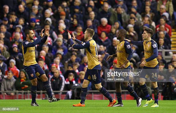 Aaron Ramsey of Arsenal celebrates scoring his team's first goal with his team mates Theo Walcott Joel Campbell and Hector Bellerin during the...