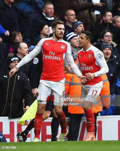 Aaron Ramsey of Arsenal celebrates scoring his team's first goal with his team mate Alexis Sanchez during the Barclays Premier League match between...