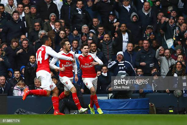Aaron Ramsey of Arsenal celebrates scoring his team's first goal with his team mates Hector Bellerin and Francis Coquelin during the Barclays Premier...