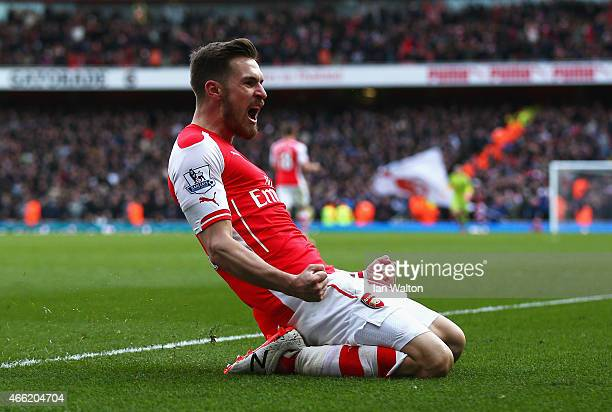 Aaron Ramsey of Arsenal celebrates scoring his team's second goal during the Barclays Premier League match between Arsenal and West Ham United at...