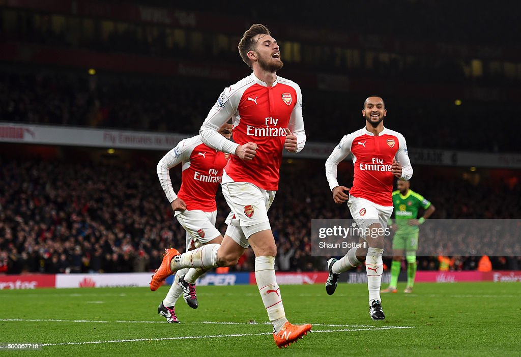 Aaron Ramsey of Arsenal celebrates scoring his team's third goal during the Barclays Premier League match between Arsenal and Sunderland at Emirates Stadiumon December 5, 2015 in London, England.