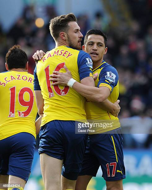 Aaron Ramsey of Arsenal celebrates scoring the only goal of the game with Alexis Sanchez during the Barclays Premier League match between Burnley and...
