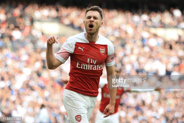 Aaron Ramsey of Arsenal celebrates scoring the opening goal during the Premier League match between Tottenham Hotspur and Arsenal FC at Wembley...