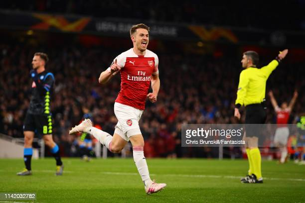 Aaron Ramsey of Arsenal celebrates scoring the opening goal during the UEFA Europa League Quarter Final First Leg match between Arsenal and S.S.C....