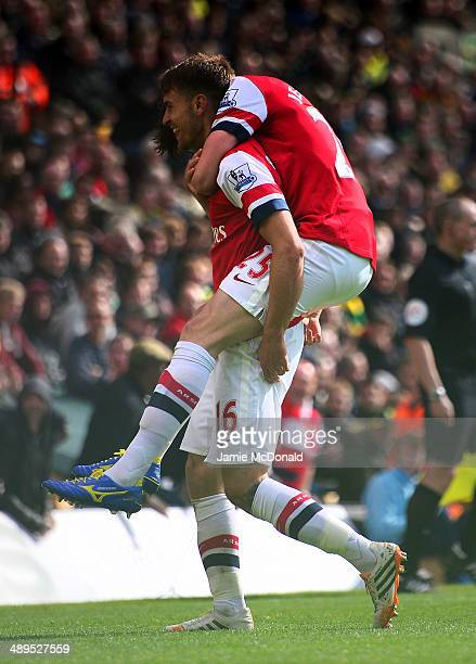 Aaron Ramsey of Arsenal celebrates scoring the opening goal with Carl Jenkinson of Arsenal during the Barclays Premier League match between Norwich...