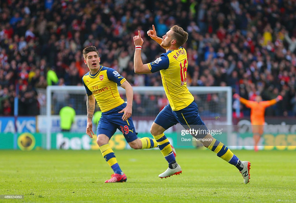 Aaron Ramsey of Arsenal celebrates scoring the opening goal with Hector Bellerin of Arsenal during the Barclays Premier League match between Burnley and Arsenal at Turf Moor on April 11, 2015 in Burnley, England.