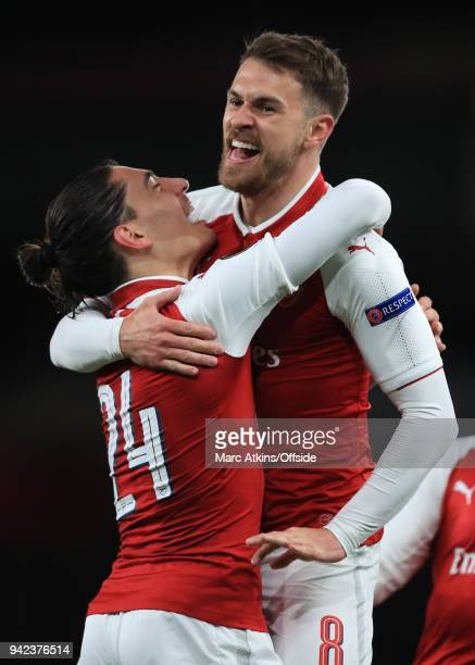 Aaron Ramsey of Arsenal celebrates scoring the opening goal with Hector Bellerin during the UEFA Europa League quarter final leg one match between...