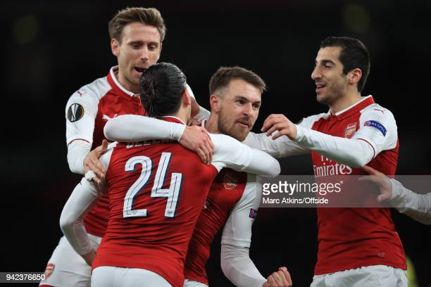 Aaron Ramsey of Arsenal celebrates scoring the opening goal with team mates during the UEFA Europa League quarter final leg one match between Arsenal...
