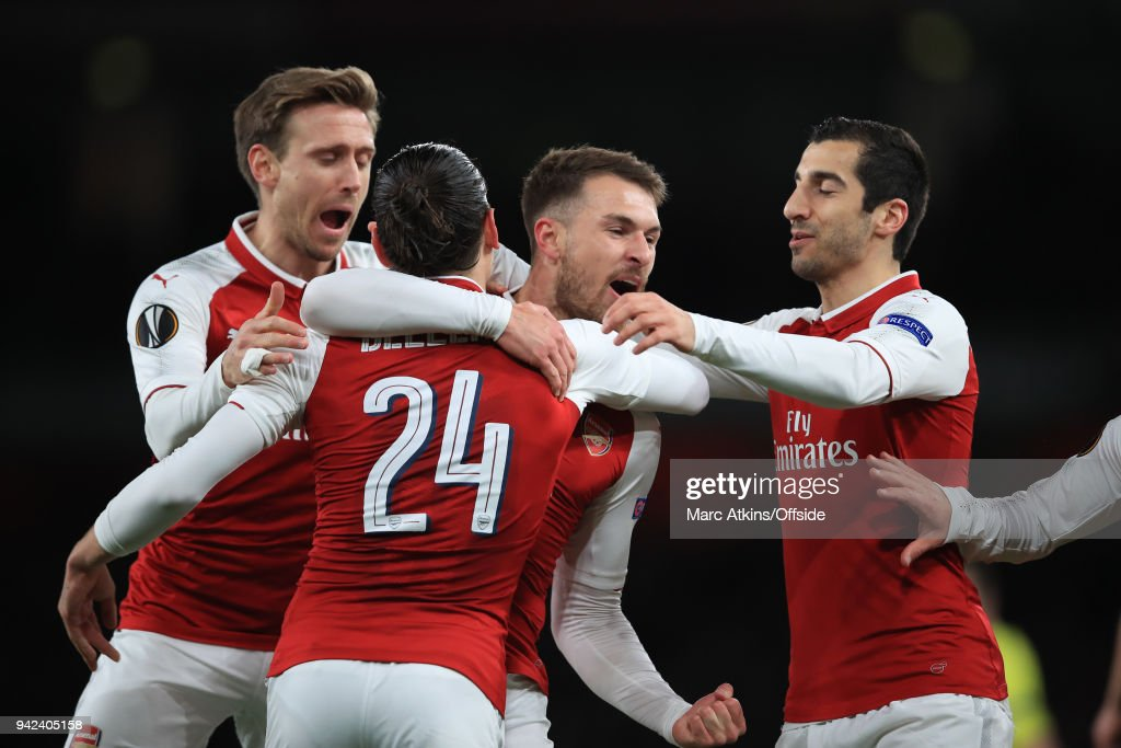 Aaron Ramsey of Arsenal celebrates scoring the opening goal with team mates during the UEFA Europa League quarter final leg one match between Arsenal FC and CSKA Moskva at Emirates Stadium on April 5, 2018 in London, United Kingdom.