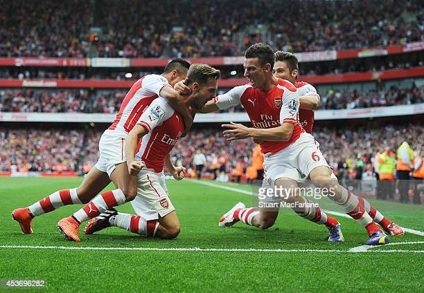 Aaron Ramsey of Arsenal celebrates scoring their 2nd goal with Alexis Sanchez and Laurent Koscielny and Mikel Arteta during the Barclays Premier...