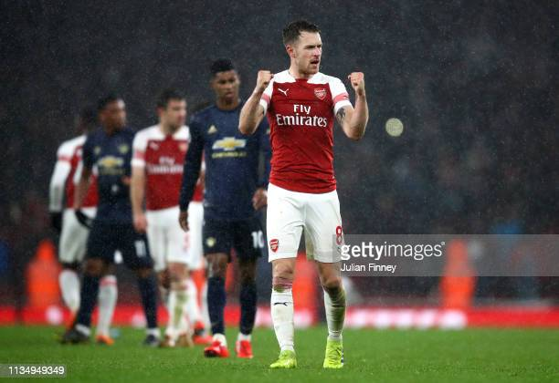 Aaron Ramsey of Arsenal celebrates victory following the Premier League match between Arsenal FC and Manchester United at Emirates Stadium on March...