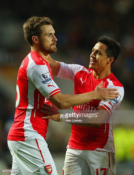 Aaron Ramsey of Arsenal celebrates with Alexis Sanchez as he scores their second goal during the Barclays Premier League match between Hull City and...