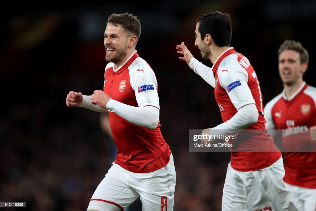 Aaron Ramsey of Arsenal celebrates with Henrikh Mkhitaryan during the UEFA Europa League quarter final leg one match between Arsenal FC and CSKA Moskva at Emirates Stadium on April 5, 2018 in London, United Kingdom.
