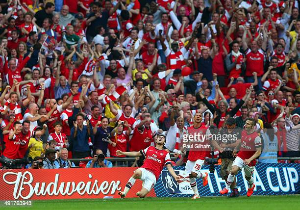 Aaron Ramsey of Arsenal celebrates with Kieran Gibbs and Jack Wilshere as he scores their third goal during the FA Cup with Budweiser Final match...