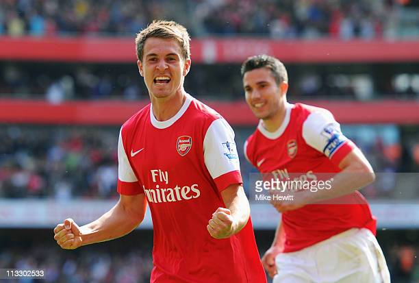 Aaron Ramsey of Arsenal celebrates with Robin van Persie as he scores their first goal during the Barclays Premier League match between Arsenal and...