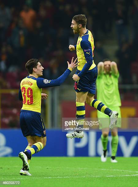 Aaron Ramsey of Arsenal celebrates with team mate Hector Bellerin as goalkeeper Wojciech Szczesny of Arsenal reacts as he scores their third goal...