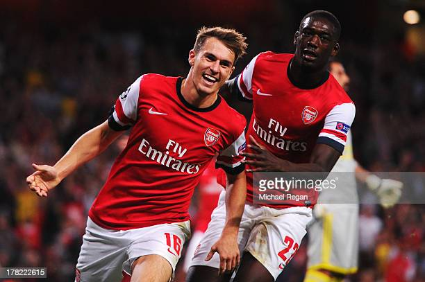 Aaron Ramsey of Arsenal celebrates with team mate Yaya Sanogo after scoring his sides second goal during the UEFA Champions League Play Off Second...