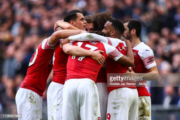 Aaron Ramsey of Arsenal celebrates with team mates after scoring a goal to make it 01 during the Premier League match between Tottenham Hotspur and...