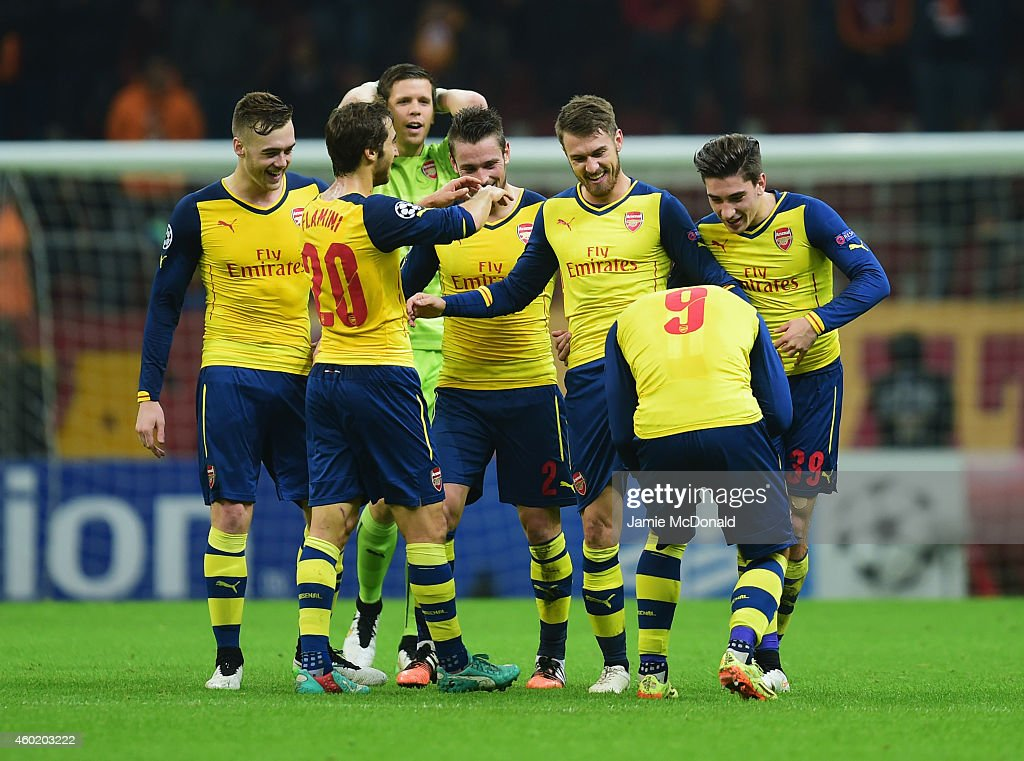 Aaron Ramsey of Arsenal (3R) celebrates with team mates as he scores their third goal during the UEFA Champions League Group D match between Galatasaray AS and Arsenal FC at Ali Sami Yen Arena on December 9, 2014 in Istanbul, Turkey.