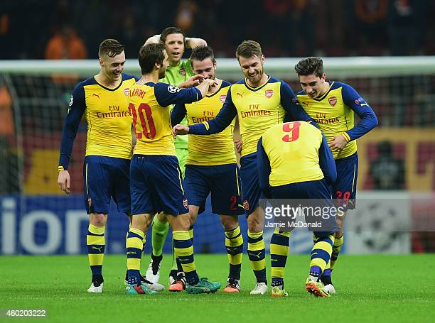 Aaron Ramsey of Arsenal celebrates with team mates as he scores their third goal during the UEFA Champions League Group D match between Galatasaray...