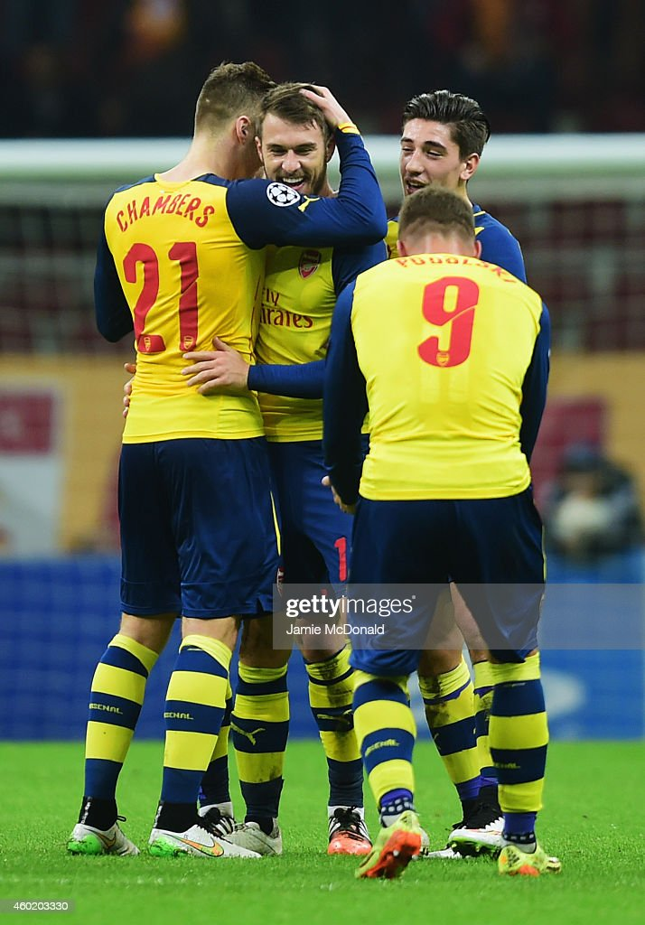 Aaron Ramsey of Arsenal (2L) celebrates with team mates as he scores their third goal during the UEFA Champions League Group D match between Galatasaray AS and Arsenal FC at Ali Sami Yen Arena on December 9, 2014 in Istanbul, Turkey.