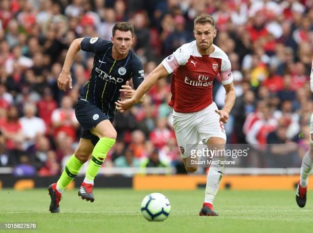 Aaron Ramsey of Arsenal challenged by Aymeric Laporte of Man City during the Premier League match between Arsenal FC and Manchester City at Emirates...