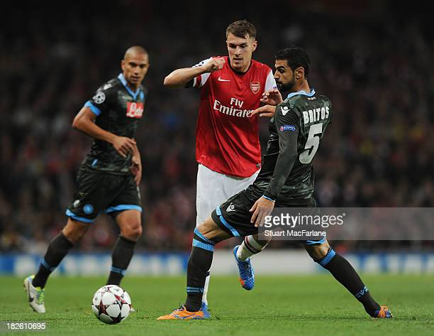 Aaron Ramsey of Arsenal challenged by Miguel Britos of Napoli during the UEFA Champions League Group F match between Arsenal FC and SSC Napoli at...