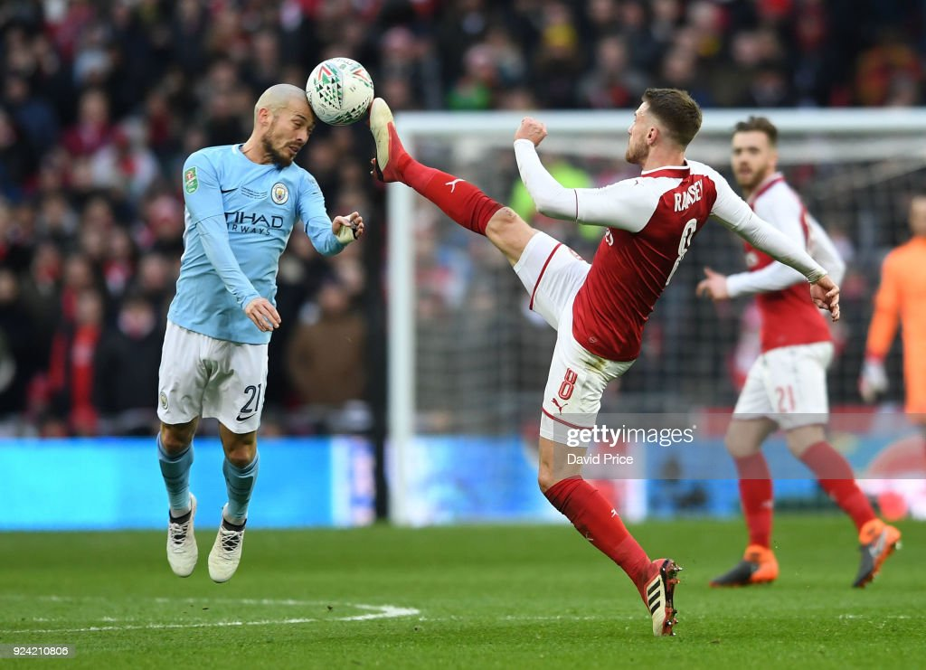 Aaron Ramsey of Arsenal challenges David Silva of Man City during the match between Arsenal and Manchester City at Wembley Stadium on February 25, 2018 in London, England.