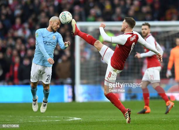 Aaron Ramsey of Arsenal challenges David Silva of Man City during the match between Arsenal and Manchester City at Wembley Stadium on February 25...