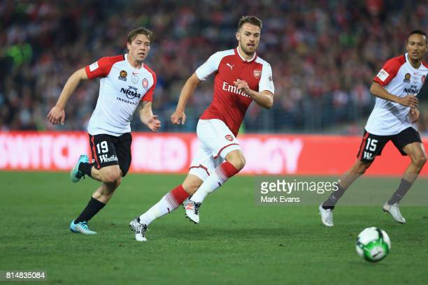 Aaron Ramsey of Arsenal chases the ball during the match between the Western Sydney Wanderers and Arsenal FC at ANZ Stadium on July 15, 2017 in...