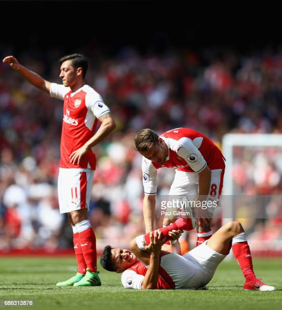 Aaron Ramsey of Arsenal checks if Alexis Sanchez of Arsenal is ok during the Premier League match between Arsenal and Everton at Emirates Stadium on...