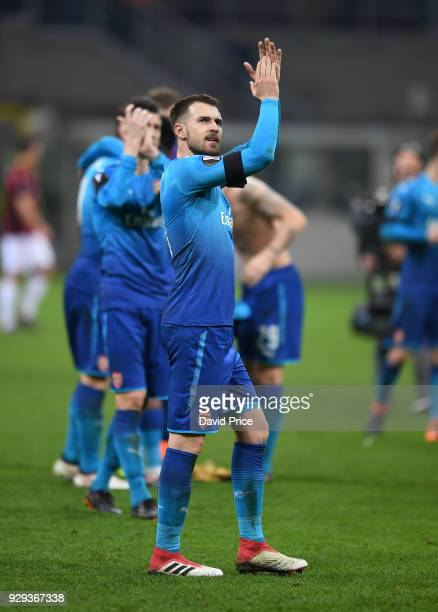 Aaron Ramsey of Arsenal claps the fans after UEFA Europa League Round of 16 match between AC Milan and Arsenal at the San Siro on March 8 2018 in...