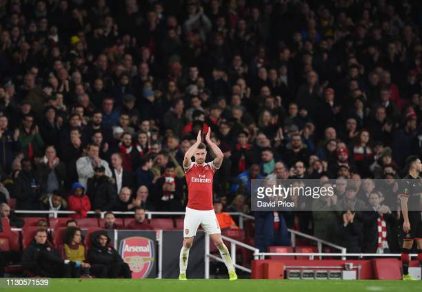 Aaron Ramsey of Arsenal claps the fans as he is substituted during the UEFA Europa League Round of 16 Second Leg match between Arsenal and Stade...