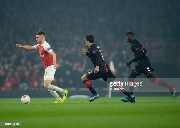Aaron Ramsey of Arsenal Clement Grenier of Stade Rennes and Mbaye Niang of Stade Rennes battle for the ball during the UEFA Europa League Round of 16...
